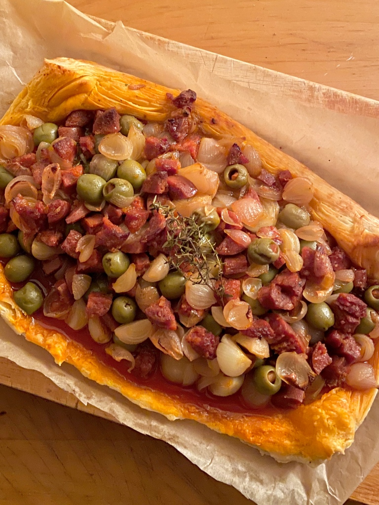 Loaded chorizo & shallot tart is beautiful Spanish flavors in a casual supper!